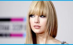 frisuren-mit-geradem-pony-und-stufen-glatt-lang-haare-blond-taylor-swift